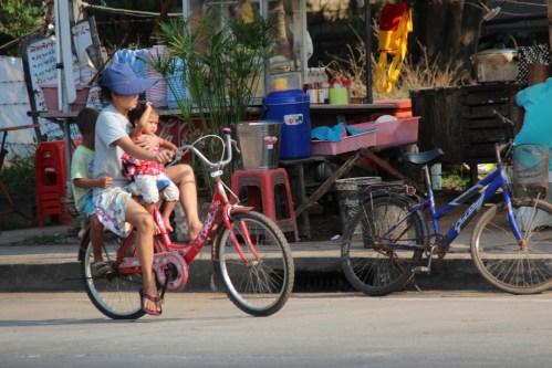 Bike riding in a Thai village