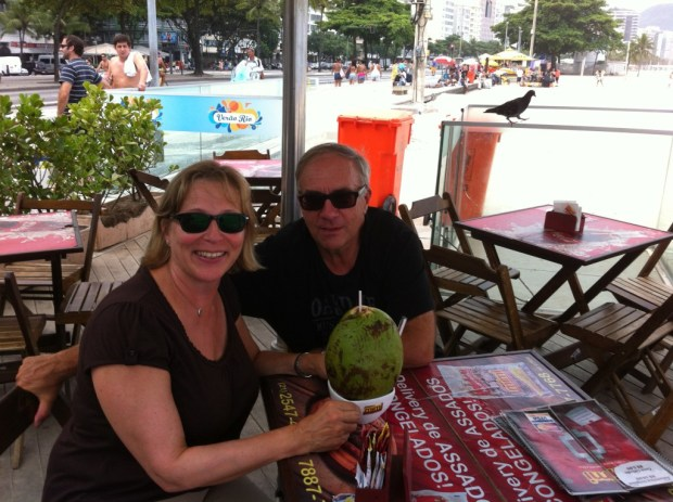 Drinking coconut milk at a Copacabana cafe