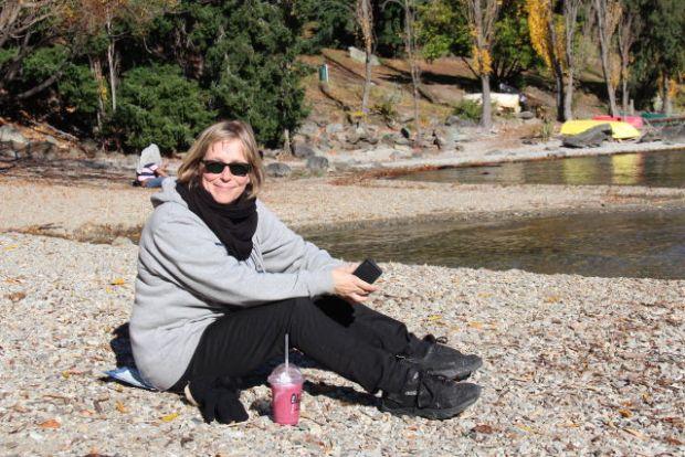 Sitting on Lake Wakatipu beach