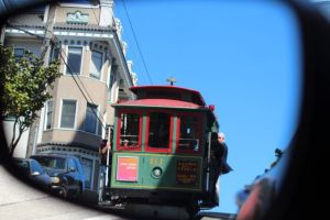 San Francisco cable car from car mirror