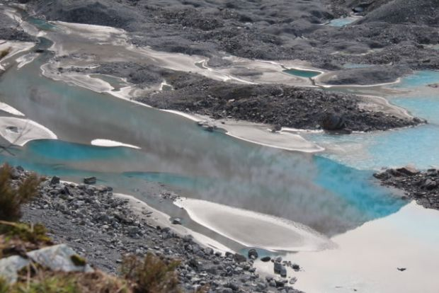 The turquoise Mueller Lake Aoraki Mount Cook