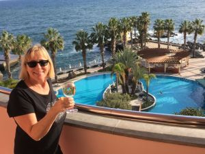 Dreaming about travel: wine on Funchal hotel balcony