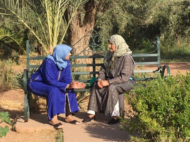Local women sitting in Menara Gardens