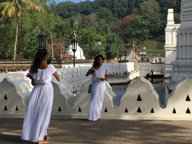 Young sisters outside Temple of the Tooth