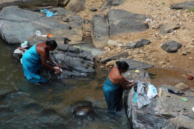 Washing laundry in river, Sri Lanka tea country
