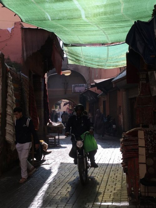 Motorbike speeding in the souks of Marrakech, Morocco