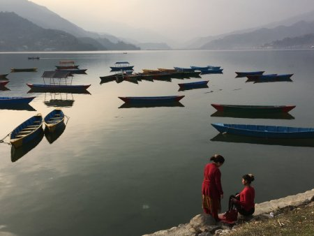 Local women and boats on Lake Phewa