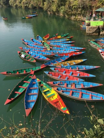 Pokhara lakeside colored boats