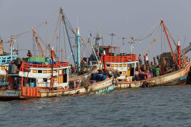 Fishing boats in Ban Phe, fishing village built on poles