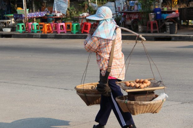 Thai village life: carrying eggs in baskets
