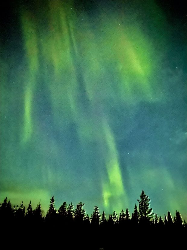 Arctic Lapland spring: northern lights dancing in the sky