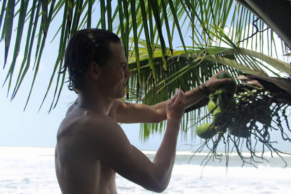picking a coconut in Costa Rica