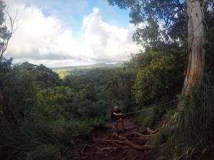 climbing down a rope in Kauai