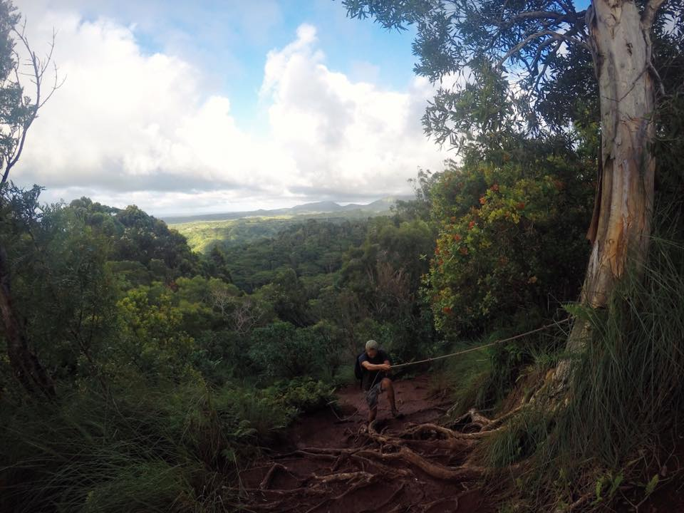 climbing down a rope in Kauai