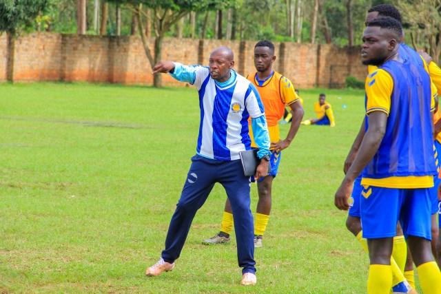 Simeon Masaba (in Sweat pants) is the head coach