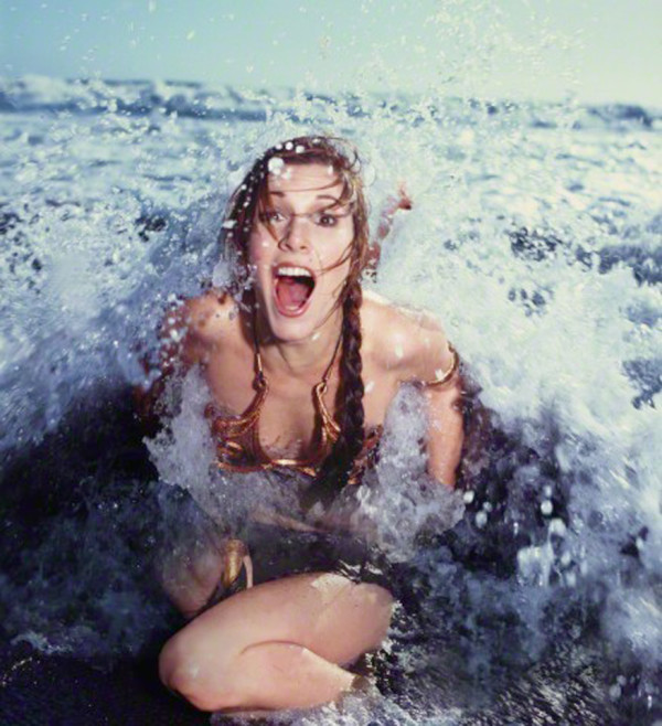 Slave Leia in crashing wave - Star Wars Rolling Stone Cover July 1983