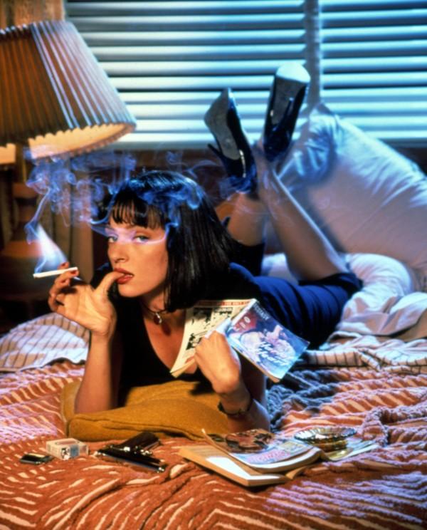 Uma Thurman as Mia Wallace Holding Pulp Magazines and Smoking Cigarette - Pulp Fiction - Quentin Tarantino
