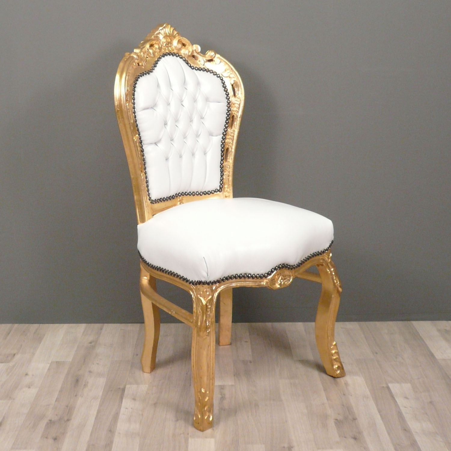 white and gold chair leather lift chairs covered by medicare baroque bronze statues
