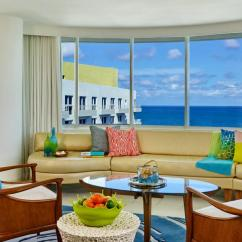 Living Room Miami Ceiling Lights For Rooms South Beach Accommodation Royal Palm Ocean View Suite With Long Fabric Couch Colourful Pillows Wooden Furniture And A Large