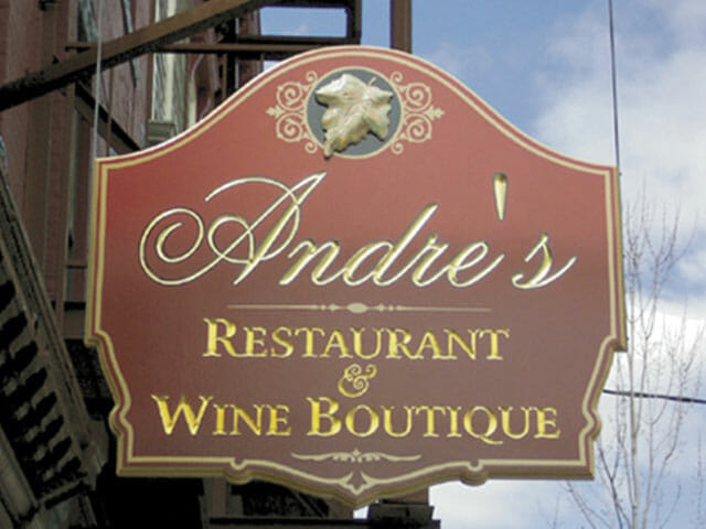 Carved Sign for Andre's Restaurant and Wine Boutique