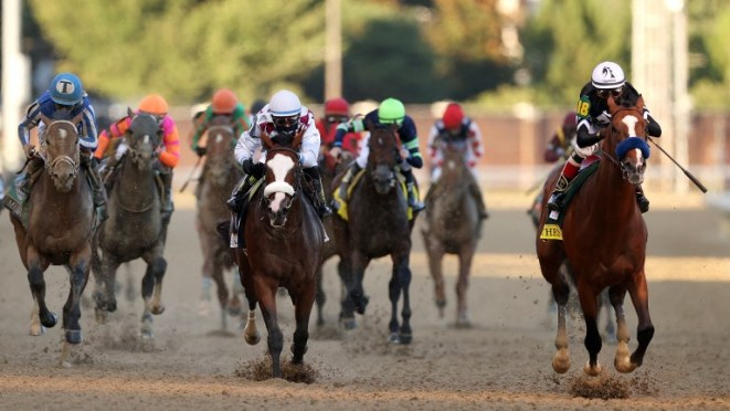 Authentic (right): pulls away from Tiz The Law at Churchill Downs
