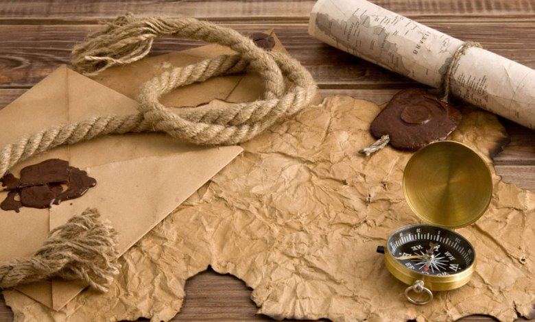 Mapa e pergaminho em cima da mesa - Imagem do Tarrasque na Bota 01 - A mina perdida de Phandelver - Episódio 1 - Um pedido de um velho amigo anão