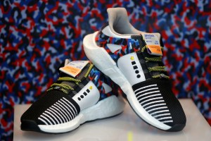 The Adidas limited-edition sneakers that match the Berlin subway seat design, and include a yearly travel pass, are displayed at the 'Overkill' shoe store in Berlin, Germany January 16, 2018. REUTERS/Fabrizio Bensch - RC1C80834420