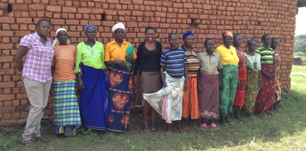 Cornell PhD student Paula Iragaba (fifth from the left) and her colleague (first from the left) together with adult women cassava farmers after a focus group discussion in the Arua district.