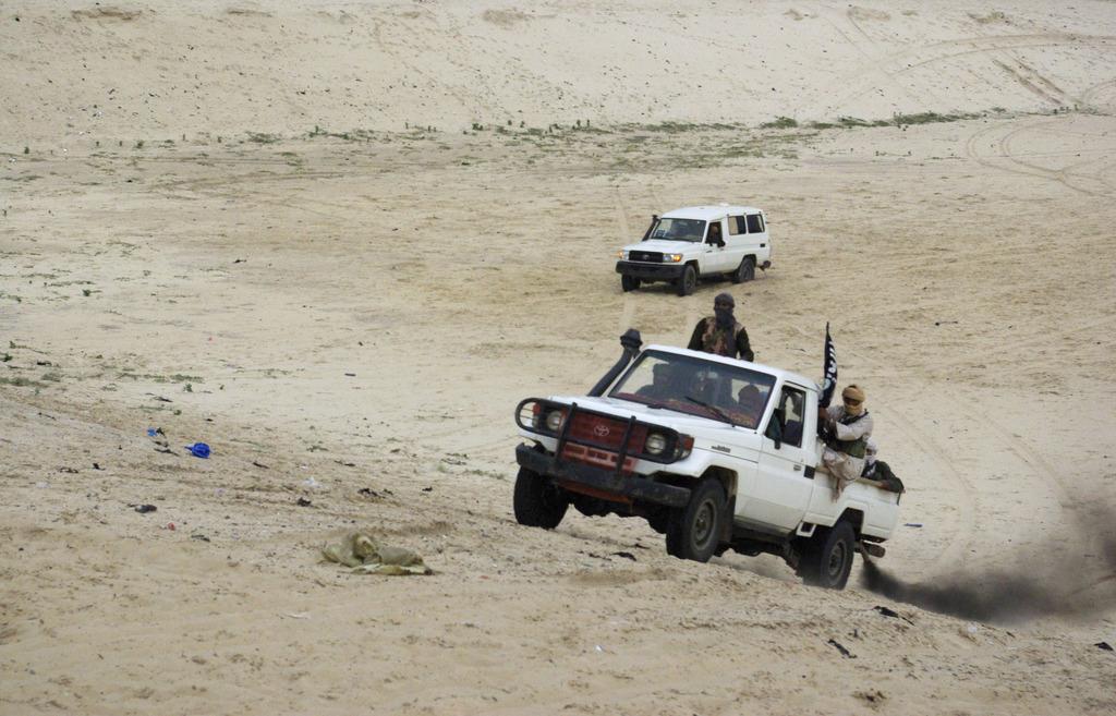 Le Mouvement islamique de l'Azawad affirme vouloir se démarquer des combattants d'Ansar Dine, ici en photo. [Keystone]