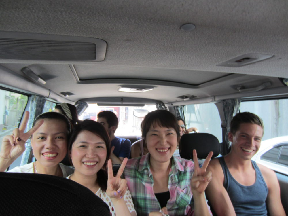 Group Of Travellers Going To Mount Taal In The Philippines