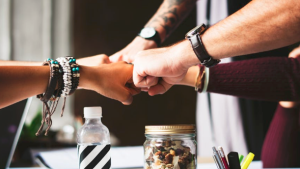 https://www.pexels.com/photo/colleagues-cooperation-fist-bump-fists-398532/