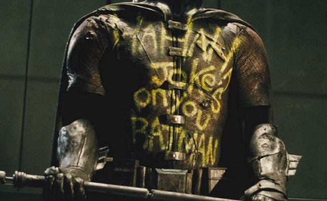 Say what you will about the Joker, it is not easy to write clearly on clothing.