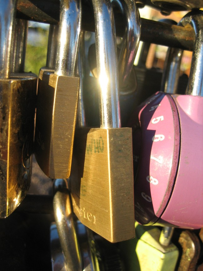 These love locks hang on a heart sculpture on North Fourth Avenue in Tucson, AZ.
