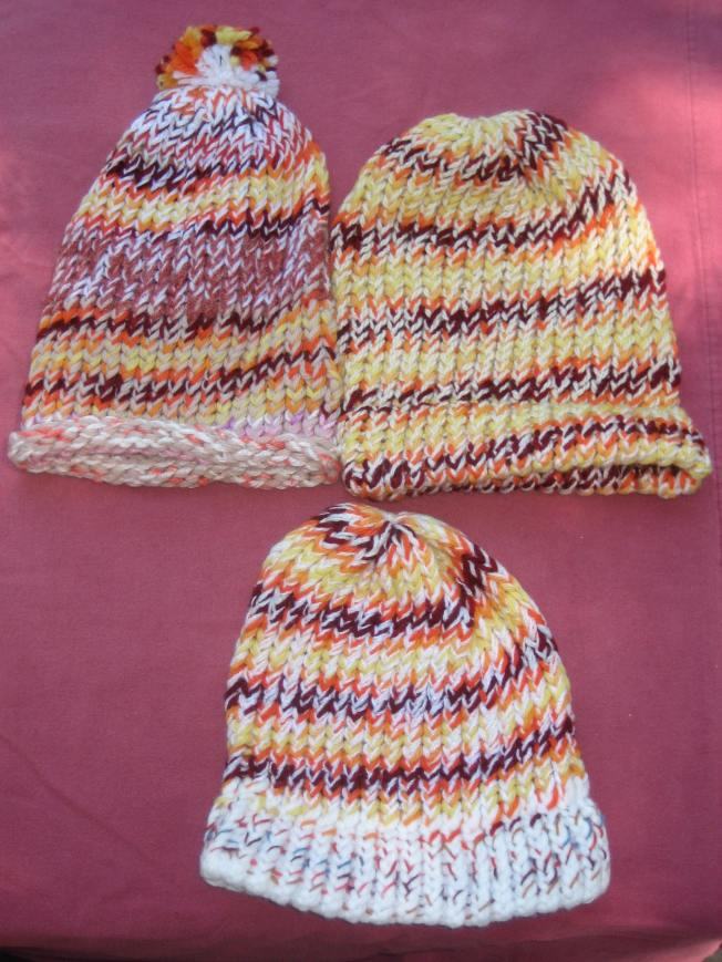 These hats in fall colors cost $13 each, including shipping. The one on the top left has a pompom and a rolled edge. The other two have rolled edges.
