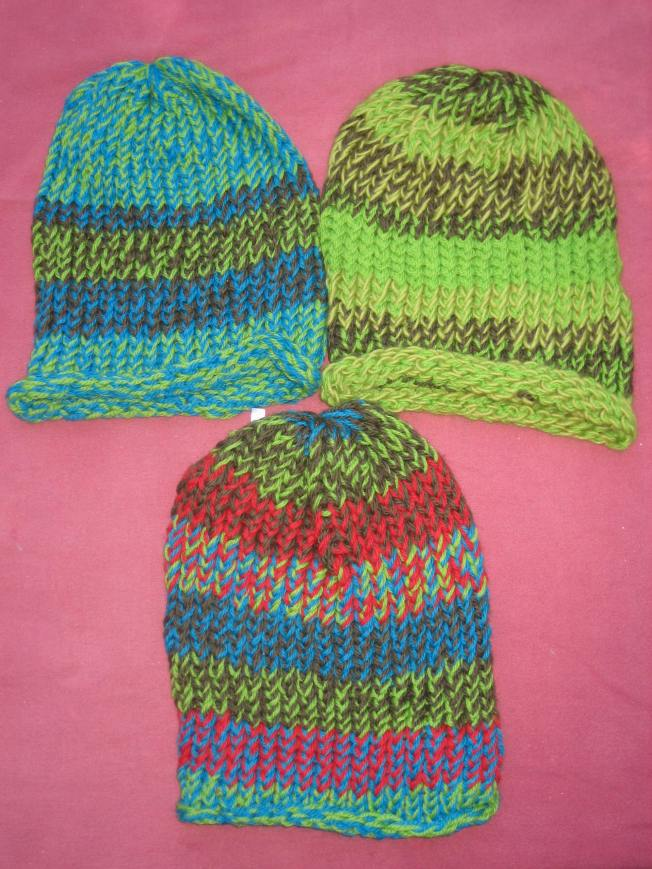 These large hats for are made from 100% wool. They cost $20, including postage. They all have rolled edges.