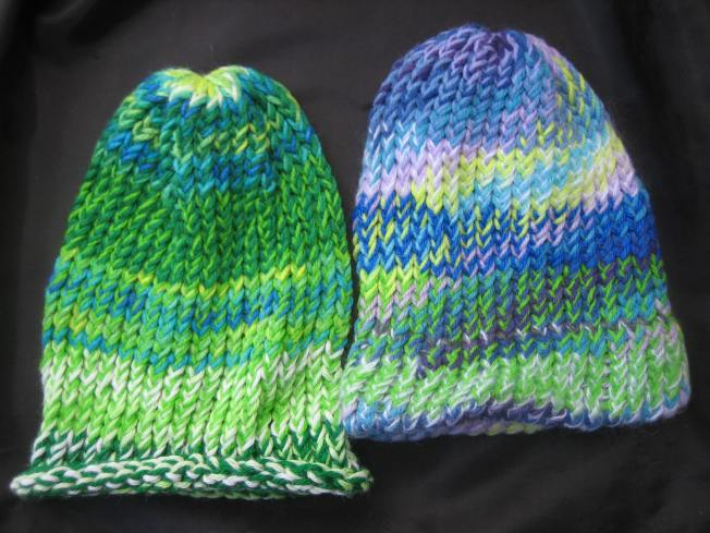 Both of these large hats feature green. The one on the left is green all over and has a rolled edge. The one on the right sports green and purple and blue and has a finished edge perfect for wearing worn flipped up or pulled down for added ear coverage. Each hat costs $13, including postage.