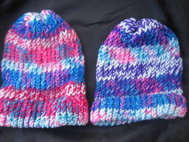 These two large hats are bright! Both sport hot pink. but the one on the right has a lot of purple in it too. Both hats have finished edges which can be flipped up or worn down for added ear coverage. Each hat costs $13, including postage.
