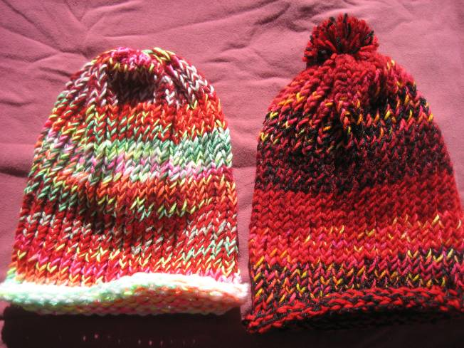 These hats are the last of the ones I made using my largest loom. Both have a rolled edge, and the one on the right sports a really cool pompom. Each hat costs $13, including postage.