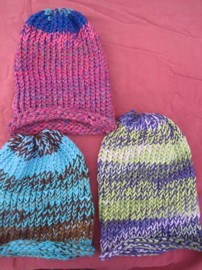 These large hats were made from yarn bought by the pound at the Goodwill Clearance Center. All three have rolled edges and cost $13 each, including postage.