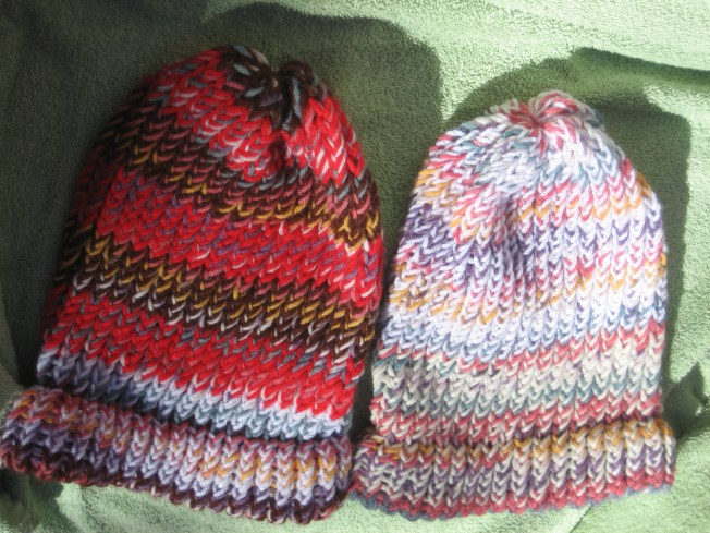 These are two more hats I made from yarn I got at the Goodwill Clearance Center. Both are large, both have a finished edge, both have sparkle white yarn in them, and both cost $13 each, including postage.