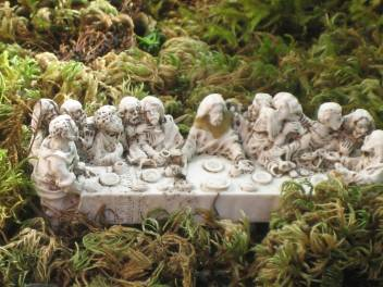 A tiny 3D replica of The Last Supper is nestled in among the moss.