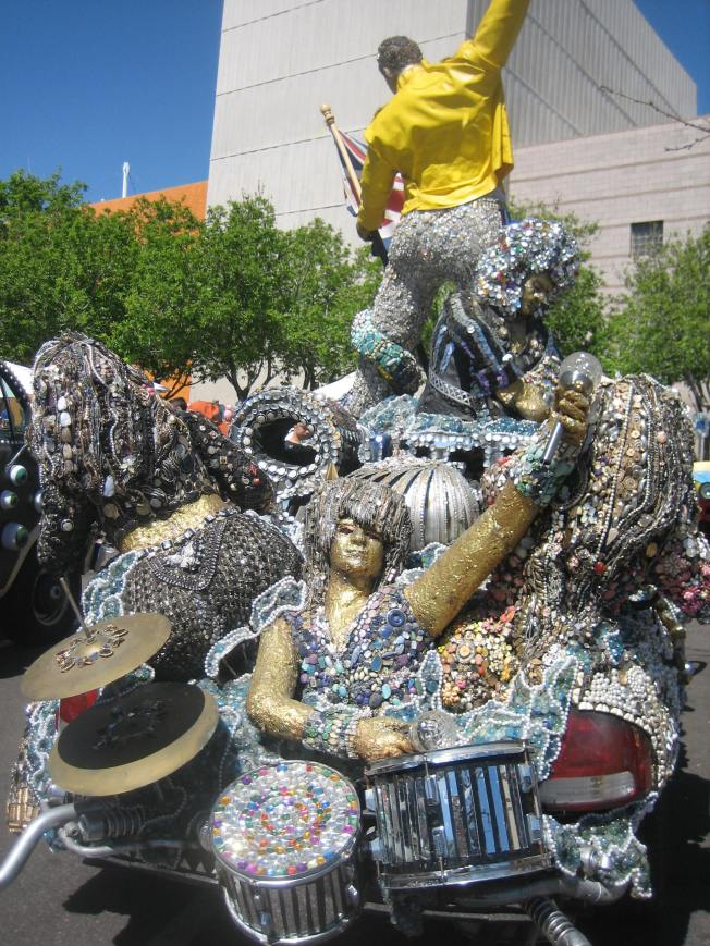 Figures of a drummer and a woman with an ample bottom adorn the back of a meticulously embellished art car.
