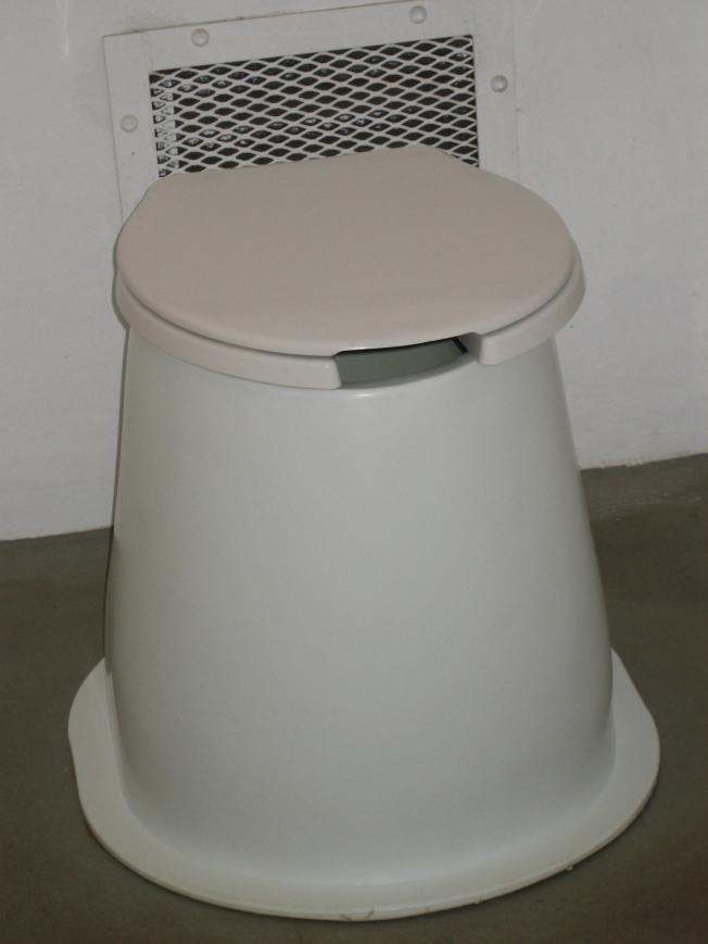 Pit toilet with lid down.