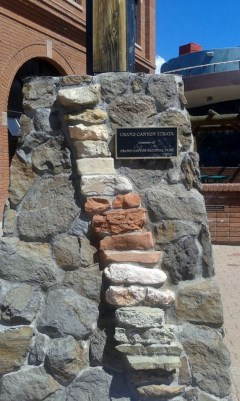 Flag pole base made of stone and including rocks from the Grand Canyon.