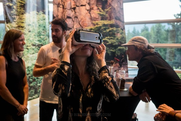 Claudia from Rejuvenation Station in the zone with hands on approach enjoying some of Brian Hockenstein's amazing Virtual Reality cinematography.