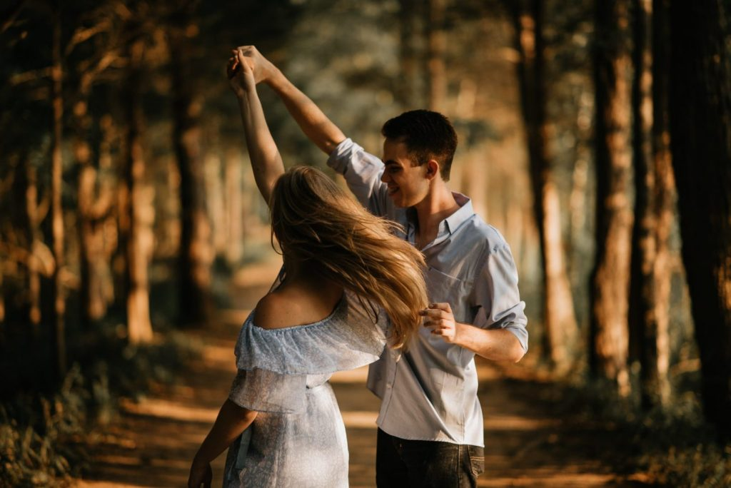 Couple Dancing In The Forest