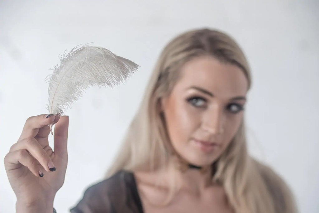 tickling Fetish dominatrix Ruby holds a feather