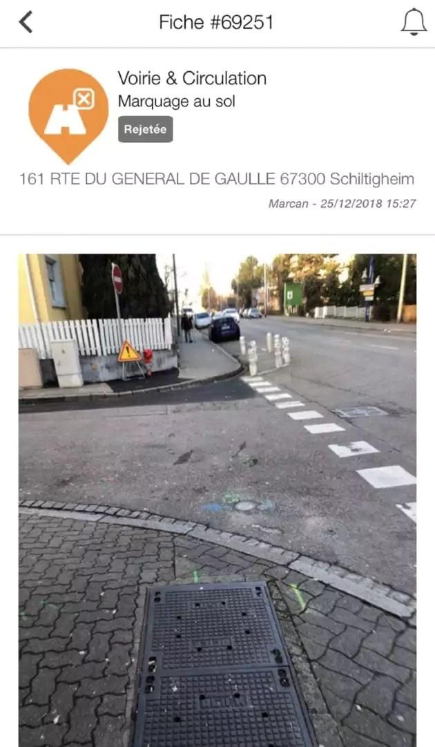 Capture d'écran de l'application Tell My City où un signalement refusé concernant un passage piéton manquant.