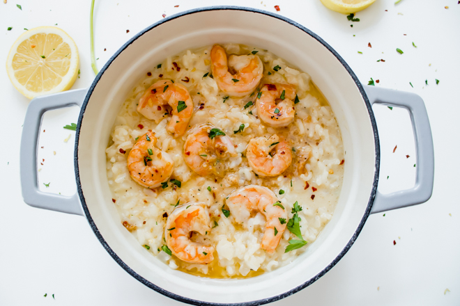 shrimp scampi on top of risotto