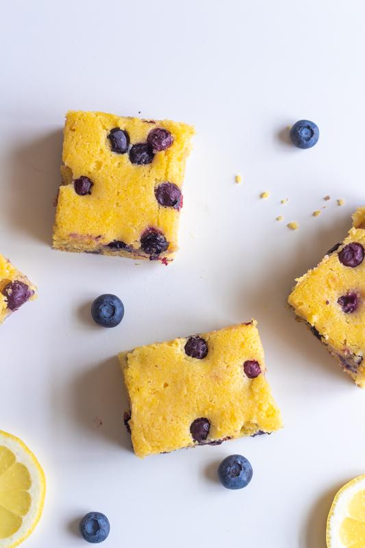 overhead shot of several squares of lemon blueberry cornbread